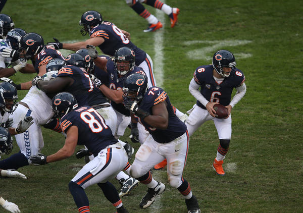 Bears quarterback Jay Cutler (6) and the offensive line in the third quarter against the Seattle Seahawks at Soldier Field Sunday, Dec. 2.