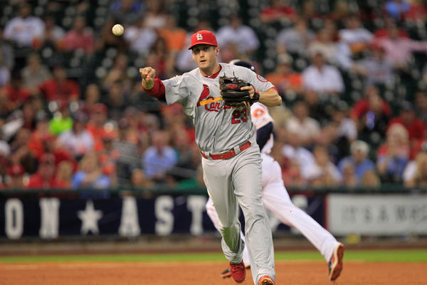 Cardinals third baseman David Freese throws out a runner against the Astros at Minute Maid Park.