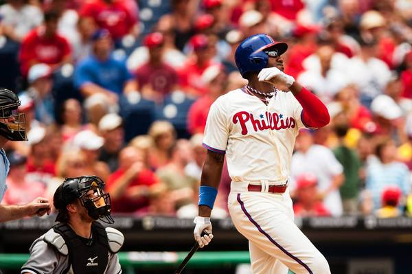 Jul 14, 2013; Philadelphia, PA, USA; Philadelphia Phillies left fielder Domonic Brown (9) hits a two RBI double during the first inning against the Chicago White Sox at Citizens Bank Park.