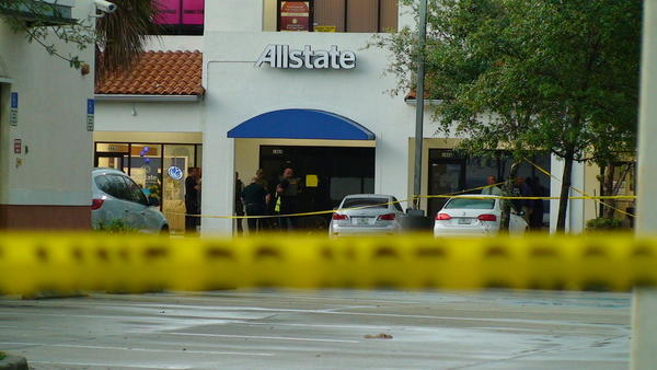 Broward sheriff's deputies fatally shot a masked gunman inside an insurance office in Pembroke Pines.