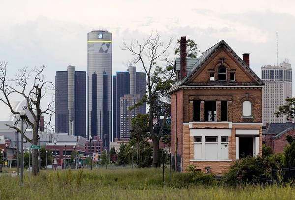The global headquarters of General Motors is visible from one of Detroit's many abandoned lots. The city declared bankruptcy Thursday.