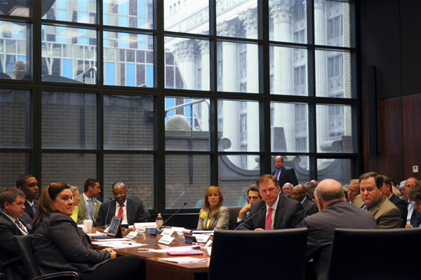 Jerry Stermer (viewed from behind, foreground right), Acting Budget Director for Illinois Gov. Quinn, speaks as a witness Thursday, June 27, 2013, before the House and Senate conference committee on pension reforms, meeting in the Bilandic Building in Chicago.