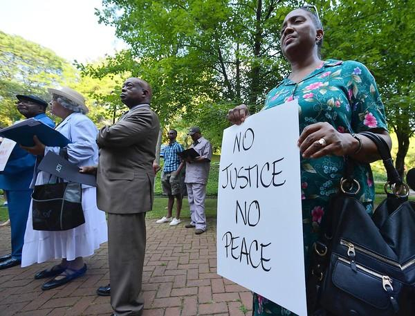 Suzanne Fredericks, of Easton, holds a sign during a Bethlehem NAACP Trayvon Martin remembrance rally held at Bethlehem's City Hall in the aftermath of the Zimmerman verdict on Thursday, July 17, 2013.