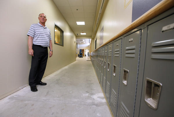 Child-sized lockers line one wall in the main hallway of the new YMCA Youth Development Center, as Steve Graf, with the Aberdeen Family YMCA, gave a tour of the facility that is expected to open August 1.
