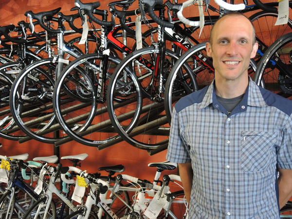 Christian Janssens, owner of Latitude 45 Bicycles and Fitness and Ride 45 Boards and BMX in Petoskey, gives safety tips on riding bicycles on Michigan roads.