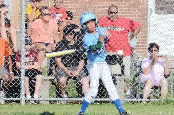 Petoskey Minor Division (ages 9-10) tournament team's Jarrin Kelly begins his swing during Thursday's District 13 game against Cheboygan. Petoskey fell to Cheboygan, 11-6. The two teams will face each other at 4:30 p.m. today, Friday, in the second and final title game in the double elimination tournament.