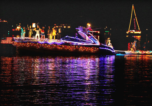 """""""Miss Money Penny,"""" owned by Bob Parmelee of Charlevoix, with the theme, 'Who made America Beautiful', was judged Best of Fleet, at the 2012 Venetian Festival boat parade."""