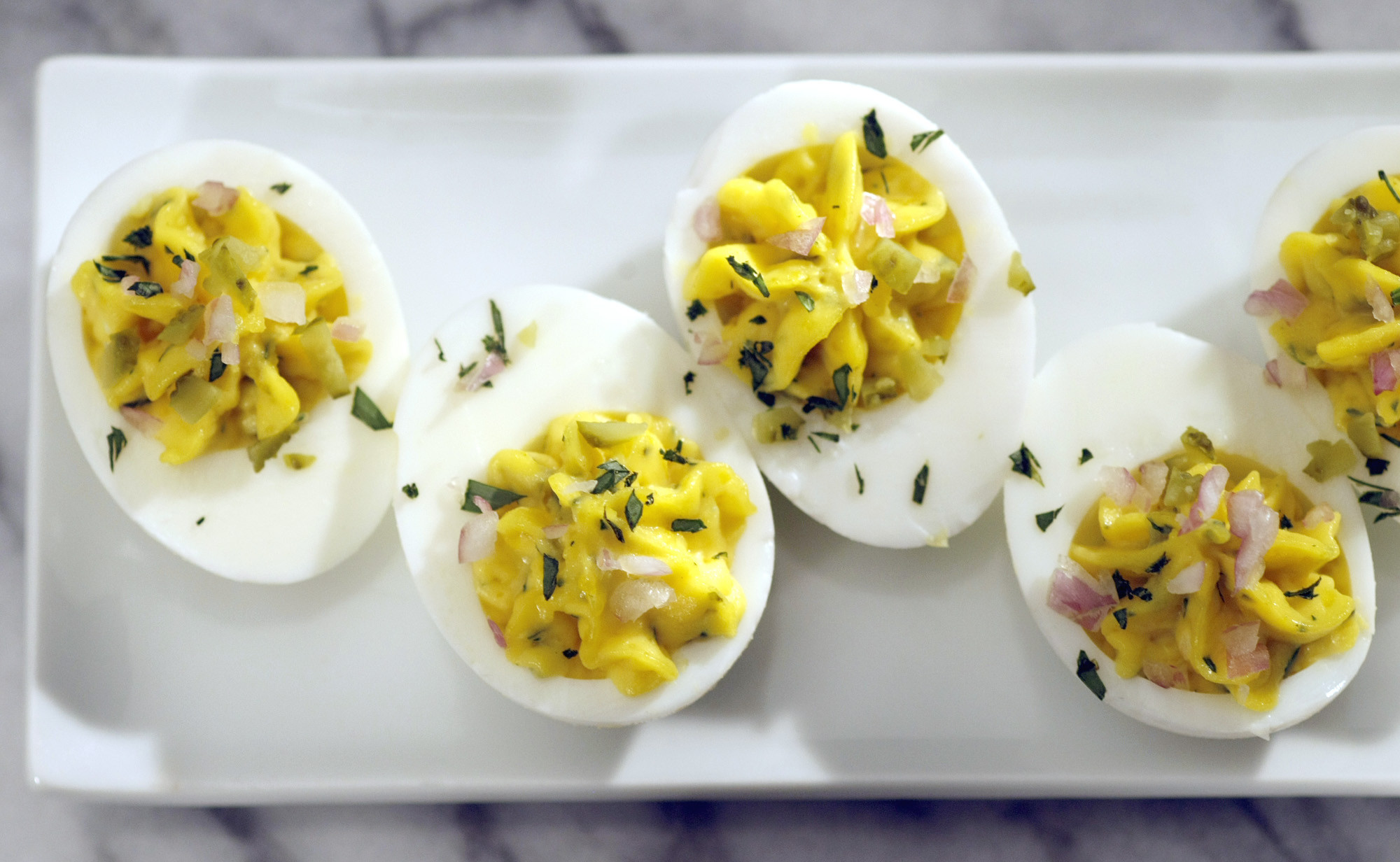 Deviled eggs with tarrragon and cornichons.