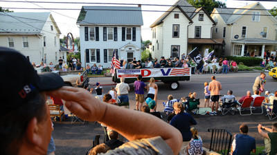 People watch the Berlin Block Party Parade as it passes through town on July 11.