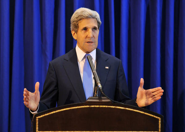 U.S. Secretary of State John F. Kerry speaks Friday during a news conference in Amman, Jordan, saying that Israeli and Palestinian negotiators will meet next week in Washington.