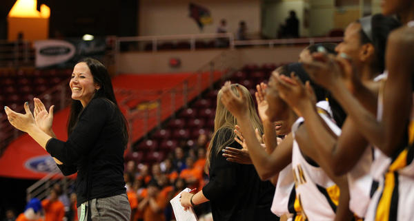 Marian Catholic coach Annie Byrne claps for her team in the final minutes of a Class 4A semifinal.