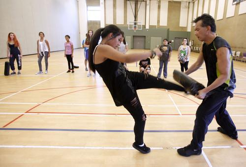 Alexandria Meneses, of Burbank, learns self defense techniques from instructor Nelson Nio at Pacific Community Center in Glendale on Tuesday.