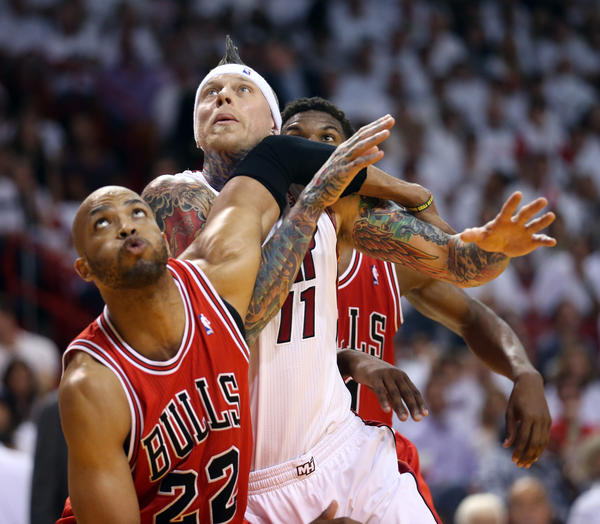 Taj Gibson makes sure that the Heat's Chris Andersen is well guarded.