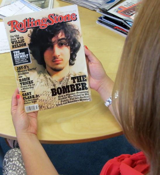 "An early copy of Rolling Stone magazine's August 2013 issue is read at an office in Los Angeles on July 17, 2013. Rolling Stone defended the cover story on Boston bombing suspect Dzhokhar Tsarnaev, which triggered criticism that the magazine was ""glamorizing terrorism"" and calls to boycott the publication. At least two national chain stores announced they would not be selling the latest issue of the magazine, known for interviews with rock stars and others. The cover picture -- showing a goateed Tsarnaev, 19, was likened to a famous Rolling Stone cover portrait of the late singer Jim Morrison of ""The Doors."" The accompanying Rolling Stones article, titled ""The Bomber,"" was described by the magazine as a ""deeply reported account of the life and times"" of Tsarnaev. The 12-page story is based on interviews with dozens of sources that ""deliver a riveting and heartbreaking account of how a charming kid with a bright future became a monster,"" it said. AFP PHOTO/Michael THURSTONMichael THURSTON/AFP/Getty Images ** TCN OUT **"