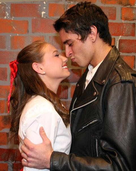 "Kim and Conrad (Sydney Rogers and Jareck Butterbrodt) share one last kiss in ""Bye Bye Birdie."""
