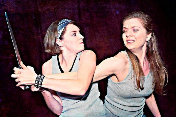 "Mary Spurlock (left) and Samantha O'Hare perform in ""Violin(ce)."""