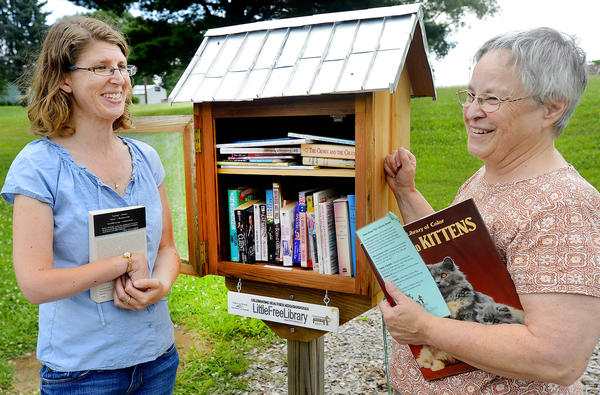 Ginger Gates, left, was the project coordinator for the Hebron Mennonite Church's Little Free Library and Betty Willson, the church's Director of Community Life, will oversee the upkeep of the library.