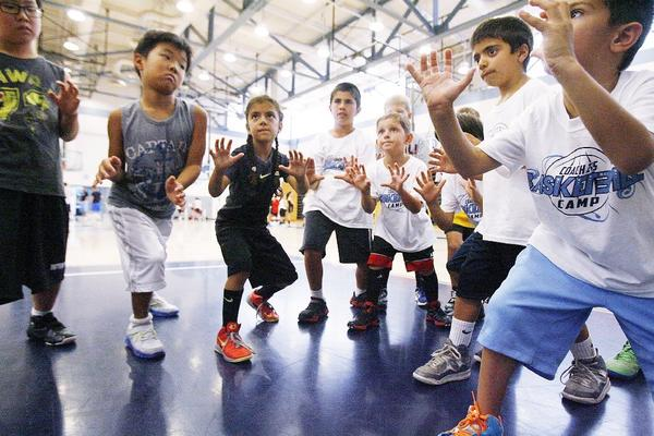 The youngest of the basketball campers learn the ready position to receive a pass as a shooter at Coach Z's Basketball Camp at Crescenta Valley High.