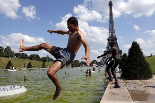 Getting in a fountain to cool down isn't novel. Getting in the Trocadero's fountains in front of the Eiffel Tower? Somehow that just seems classier.