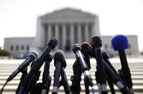 News microphones wait to capture reactions from U.S. Supreme Court rulings outside the court building in Washington, June 25, 2013.
