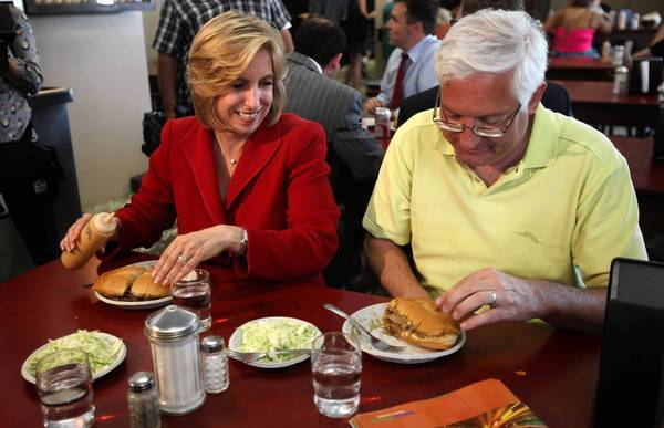 Wendy Greuel, shown with husband Dean Schramm while on the mayoral campaign trail, is enjoying a rare month off between losing to Eric Garcetti and leaving her controller's job, and deciding on her next move.
