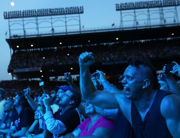 Fans cheer as Pearl Jam performs Friday, July 19, 2013 at Wrigley Field.