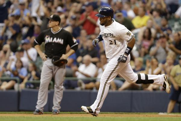 MILWAUKEE, WI - JULY 18: Juan Francisco #21 of the Milwaukee Brewers runs the bases after hitting a solo home run in the bottom of the fourth inning against the Miami Marlins at Miller Park on July 18, 2013 in Milwaukee, Wisconsin. (Photo by Mike McGinnis/Getty Images) ORG XMIT: 163494600