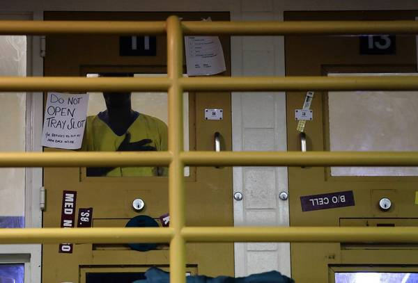An inmate stands in his cell in an observation area at the Twin Towers facility. The Los Angeles County Jail houses about 3,200 people with mental illness.