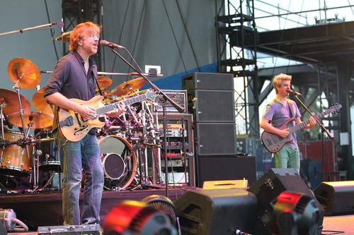 Trey Anastasio on guitar, left, and Mike Gordon on bass, right, during the Phish concert at FirstMerit Bank Pavilion at Northerly Island, Friday, July 19, 2013.