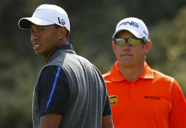 Tiger Woods and Lee Westwood wait on the third tee Saturday.
