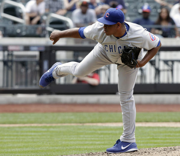 Carlos Marmol pitches against the Mets in June.