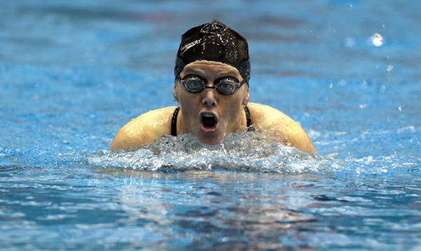 Liz Hogan competes in the 200-meter individual medley during the first day of competition of the 2013 Senior Games in Cleveland.