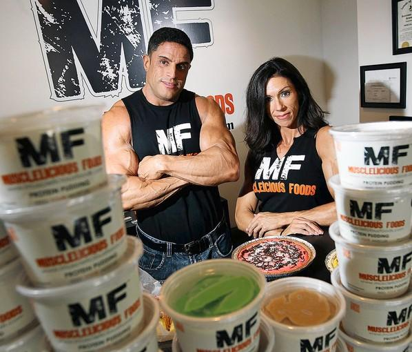 Husband and wife owners Cipriano Pereira and Sharin Pereira at their new store, Musclelicious Foods, in Wilson on Tuesday.