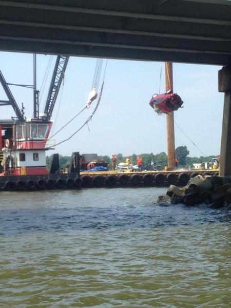 A car is removed from the waters below the Chesapeake Bay Bridge on Saturday.