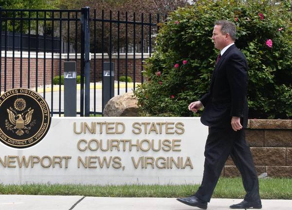 Jeffrey A. Martinovich exits the federal courthouse in Newport News on April 30.