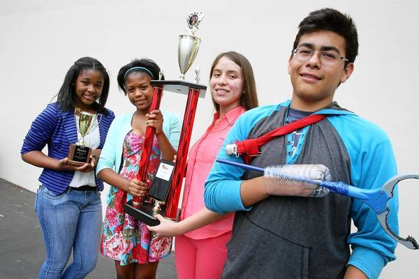 Markham Middle School students, from left, Ashley Baker, Danae Tousant, Jacqueline Sanchez and Julio Romero won MESA USA's national engineering competition by building a prosthetic arm.
