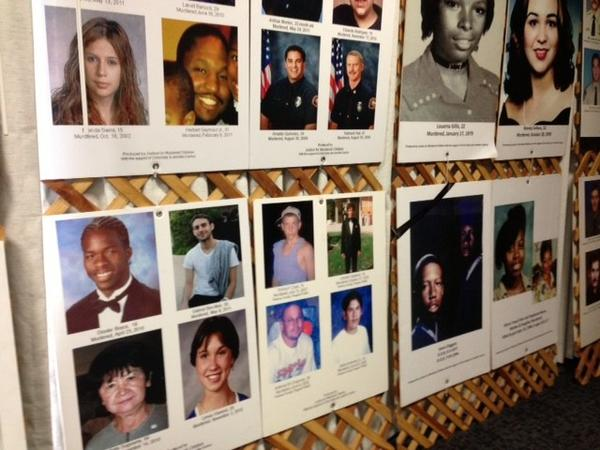 Photo: The faces of homicide victims on posters at a summit for victims of unsolved murder in a conference room at the L.A. Sheriff's Department Headquarters in Monterey Park. Credit: Nicole Santa Cruz, Los Angeles Times