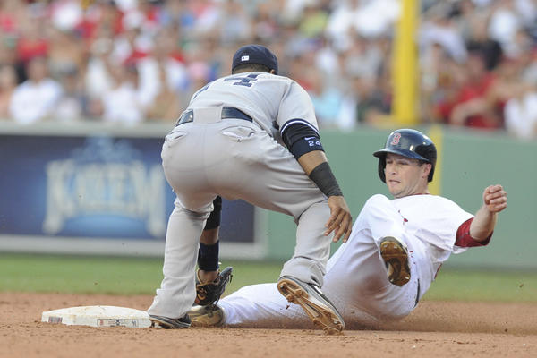 Yankees second baseman Robinson Cano tags out Daniel Nava of the Red Sox during the eighth inning Saturday at Fenway Park.