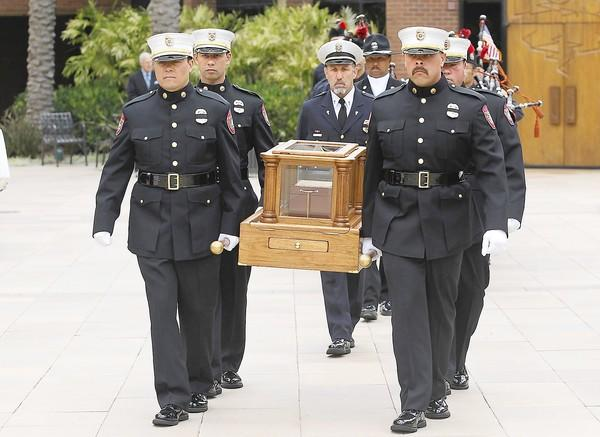 Members of the Anaheim Fire Depatment's Search and Rescue team carry the remains of Grant McKee, 21, for his memorial service in the St. Andrew's Presbyterian Church sanctuary, Saturday. McKee grew up in Costa Mesa and was one of 19 members of the Granite Mountain Hotshot firefighting crew killed in fast moving wildfire in Prescott, AZ.