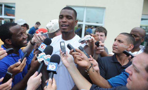 Miami Dolphins first round pick, Dion Jordan of Oregon, is surrounded by media during the first day of training camp, Sunday, July 21, 2013, at Nova Southeastern University in Davie.