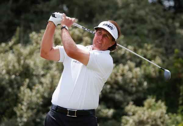 Phil Mickelson tees off from the 3rd tee during the final round of the British Open Sunday. (Rob Carr/Getty Images)