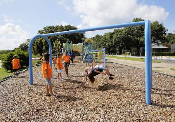 Boys and Girls Club of Lake and Sumteralong with community volunteers, built a unique children's park and playground on the shore of Lake MInneola. ( Tom Benitez/Orlando Sentinel)