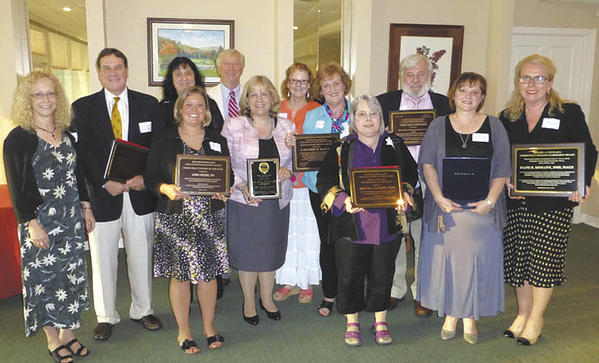 Front row, from left, Susan Stewart, center executive director; Dr. Richard Colgan of the University of Maryland School of Medicine; Audra Houser, nurse practicioner; Lisa McCoy, Dietitian of the Year; Judyth L. Altemus, mental health practitioner; Jennifer Glotfelty, social worker; and Dr. Diane D. Romaine. Second row, Angela Spataro, nurse; Charles Breakall, center board of directors chairman; Kelsey M. Wilkes, social worker; Anne Sheetz, nurse; and John Kenney, social worker.