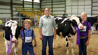 From left are Hunter Cornell, Reserve Grand Champion Dairy Beef; Annie Cekada, judge; and Brooke Cornell, Grand Champion Dairy Beef.