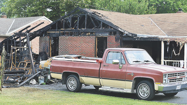 A fire Saturday destroyed this garage and damaged the home at 17300 Cloverleaf Road near Allen Avenue in Halfway.