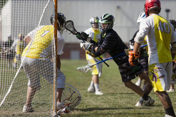 The Rip-It Ducks' attacker Matt Savage makes one last shot on goal with the score tied 7-7 in overtime during the Glastonbury Lacrosse Tournament's Green Division championship game against Team Shocker on Sunday. Savage missed his shot and Team Shocker scored again to win.