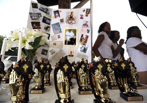 Mothers of Murdered Sons and Daughters hosts its annual memorial event at Turner Station Park. Each praying hands and cross memorial is inscribed with the name of someone killed this year by violence.