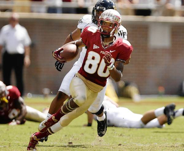 FSU punt returner Rashad Greene runs back a punt for a touchdown during the Wake Forest at Florida State University football game at Doak Campbell Stadium in Tallahassee.