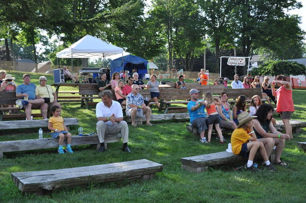 Crowd listens to local performer Randy Myers at Somerfest Sunday afternoon.