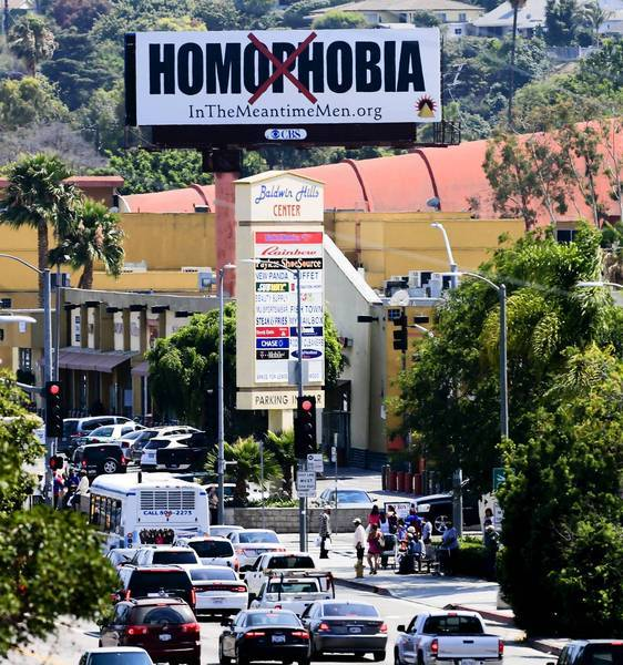 A billboard in South Los Angeles is meant to address the stigma attached to same-sex relations. It replaced a racier billboard encouraging health precautions among gay men.